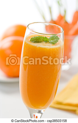 Orange and carrot juice in glass - csp38503158