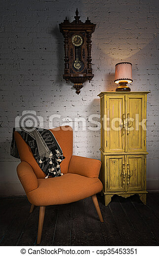 Orange armchair, yellow cupboard, pendulum clock and illuminated table lamp - csp35453351