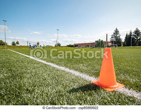 Orange border cone.  Soccer training court line - csp85889922
