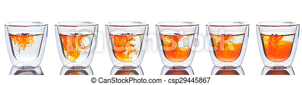 orange color spread in glass of water - csp29445867