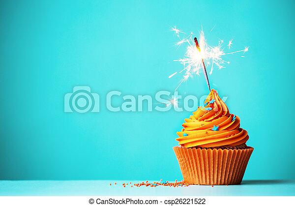 Orange cupcake with sparkler - csp26221522