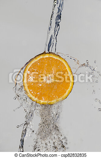 Orange in water splash on white background - csp82832835