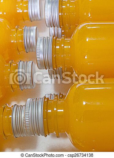 Orange juice in bottle. - csp26734138
