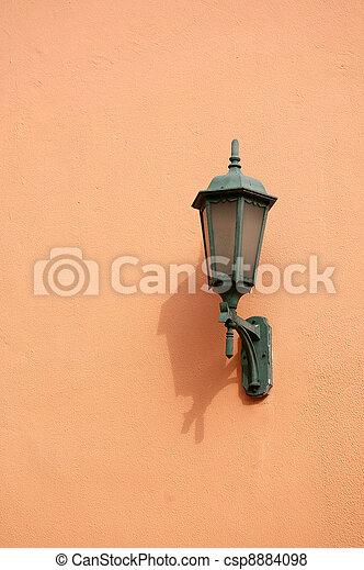 Orange lamp on wall - csp8884098