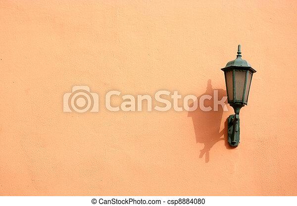 Orange lamp on wall - csp8884080