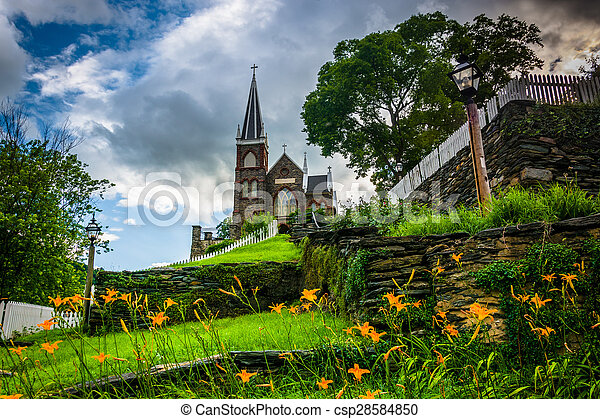 Orange lillies and St. Peters Roman Catholic Church, in Harpers Ferry, West Virginia. - csp28584850