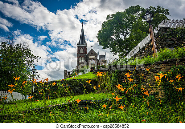 Orange lillies and St. Peters Roman Catholic Church, in Harpers Ferry, West Virginia. - csp28584852