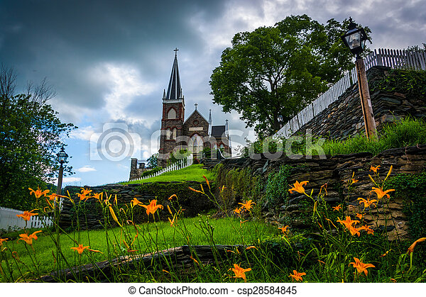 Orange lillies and St. Peters Roman Catholic Church, in Harpers Ferry, West Virginia. - csp28584845