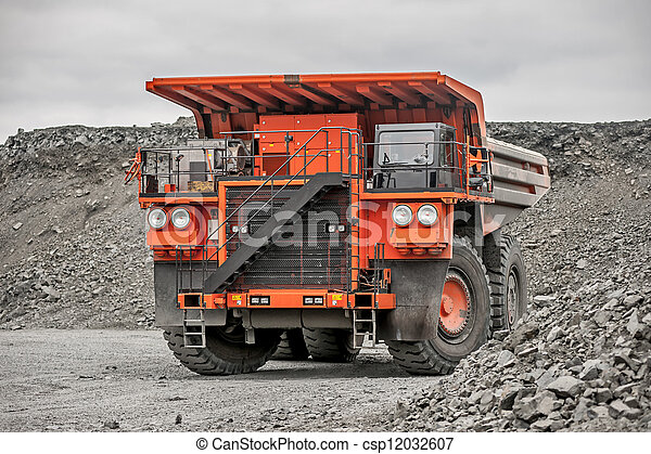 Orange mining vehicle driving in the pit - csp12032607