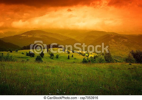 orange mist over mountains  - csp7053916