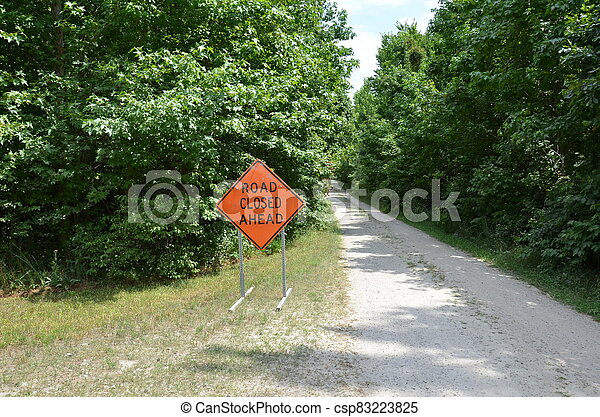 orange road closed sign with path or trail - csp83223825