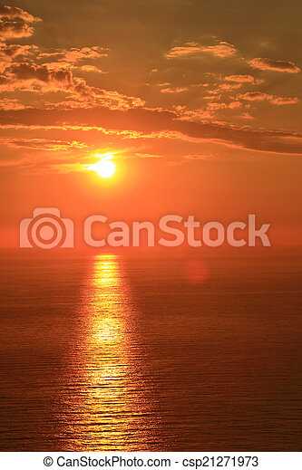 Orange sun with reflection on surface of the sea - csp21271973