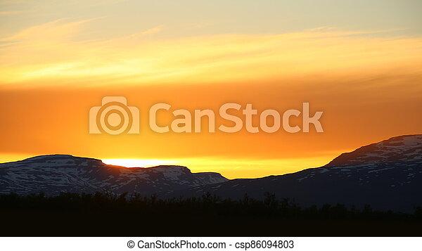 Orange sunset in Norrbotten in northern Sweden - csp86094803