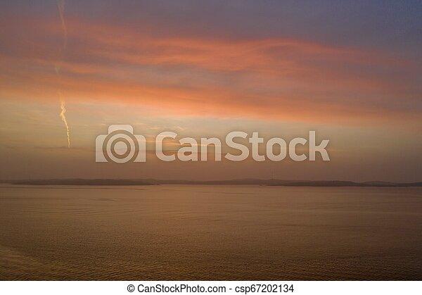 Orange sunset in winter drone photo - csp67202134