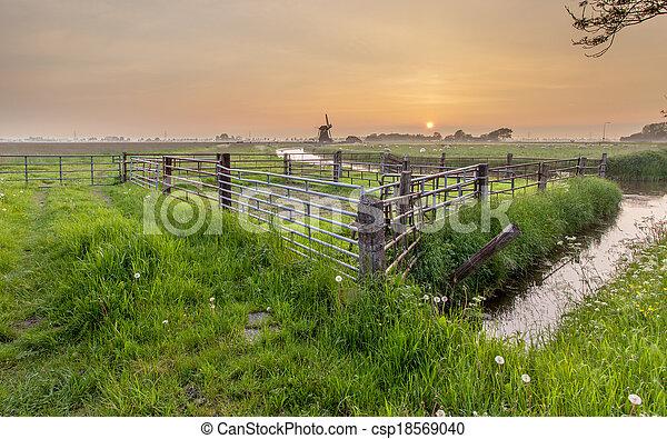 Orange Sunset over Polder Landscape - csp18569040