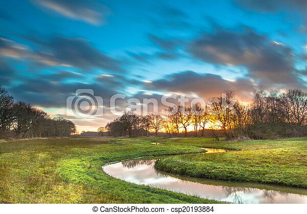 Orange Sunset over River Valley - csp20193884