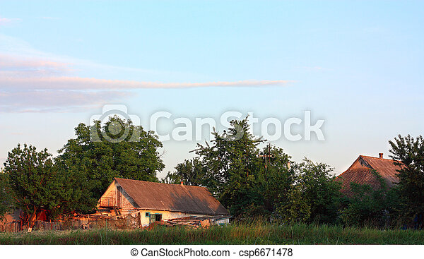 Orange sunset over the old village barn - csp6671478