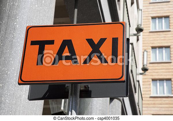 Orange taxi sign in urban setting - csp4001035
