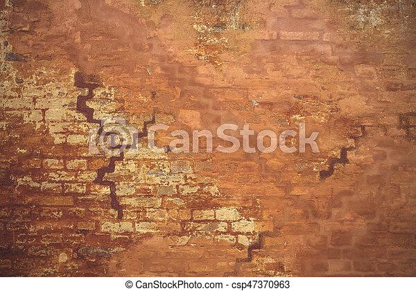 Orange wall in grunge look - csp47370963
