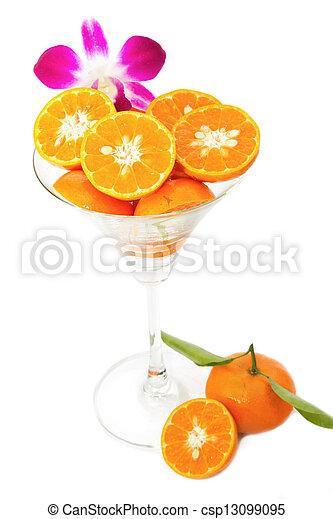 Oranges slice in cocktails glass on white background - csp13099095