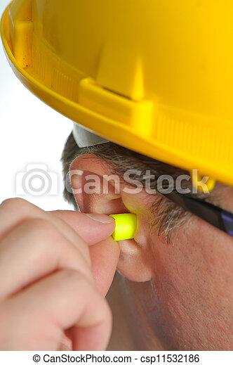 Un tapón amarillo en la oreja - csp11532186