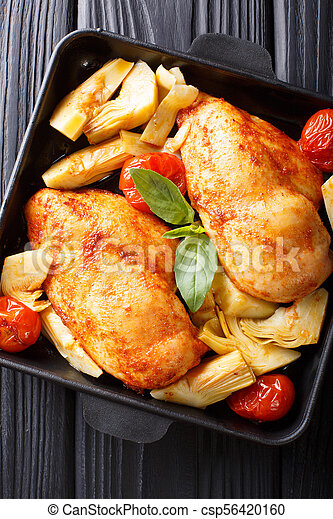 Organic food: a serving of chicken breast with artichokes and tomatoes close-up. Vertical top view - csp56420160