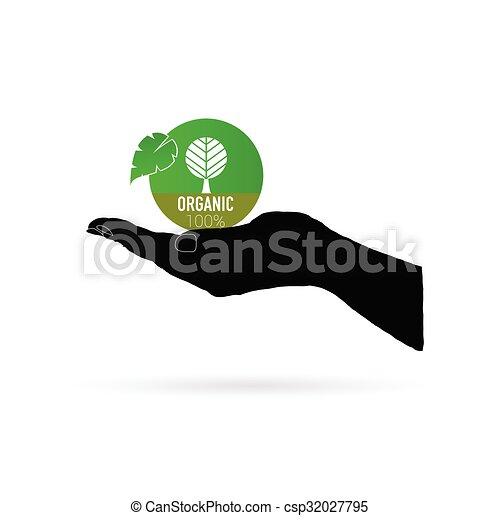 organic icon green vector in black hand - csp32027795