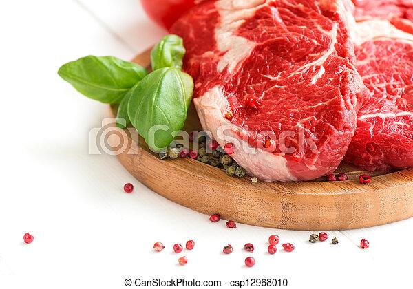 Organic Red Raw Steak on cutting board - csp12968010