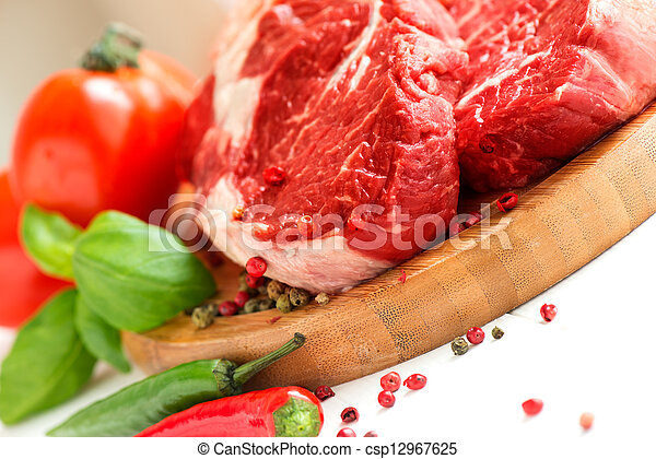 Organic Red Raw Steak on cutting board - csp12967625