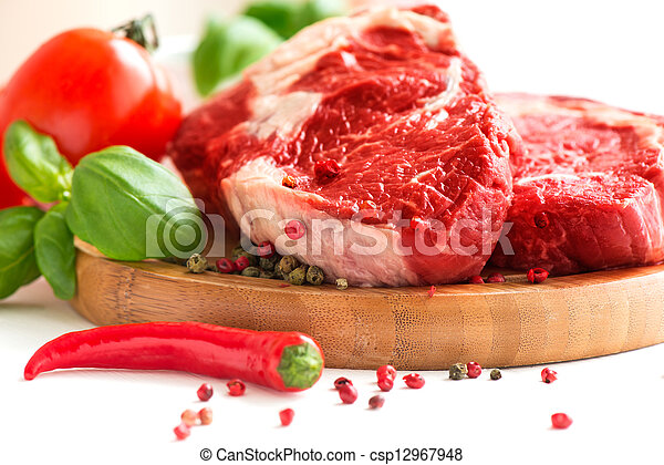 Organic Red Raw Steak on cutting board - csp12967948