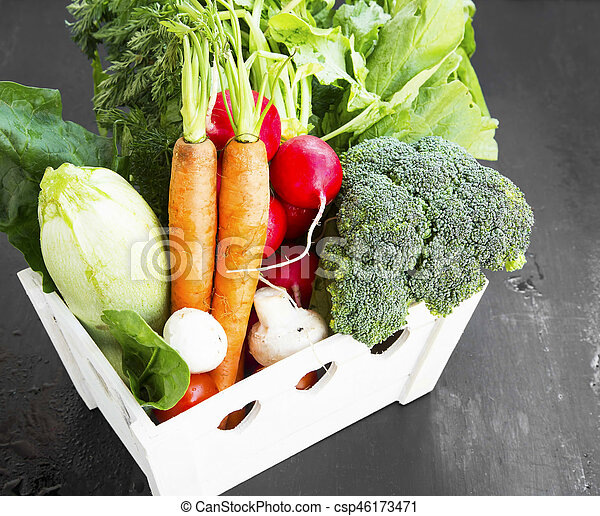 Organic vegetables harvest in wooden crate - csp46173471