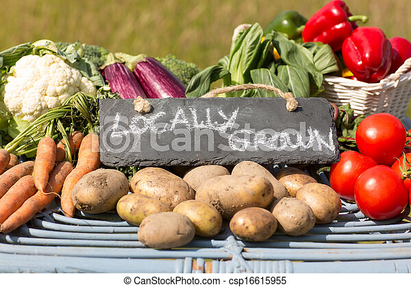 Organic vegetables on a stand at a farmers market - csp16615955