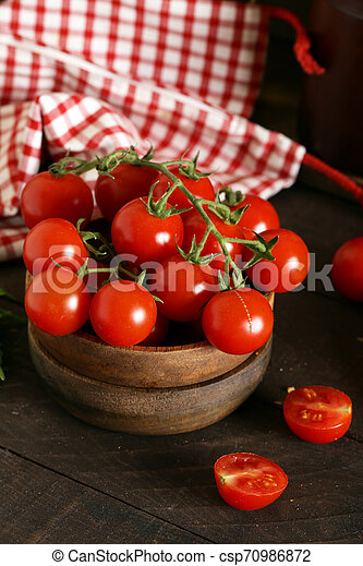 organic vegetables, tomatoes in a wooden bowl - csp70986872
