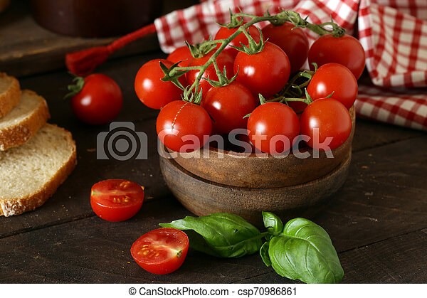 organic vegetables, tomatoes in a wooden bowl - csp70986861