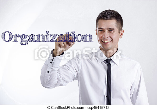 Organization - Young smiling businessman writing on transparent surface - csp45415712