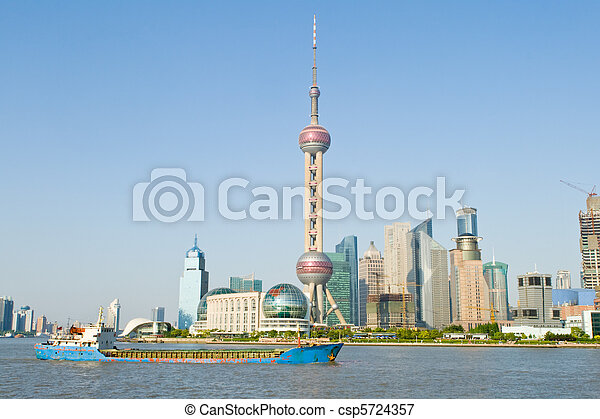Oriental Pearl TV Tower in Pudong, Shanghai, China.  Pudong is the new part of Shanghai, across the Huangpu River from old Shanghai.  Blue sky background - csp5724357