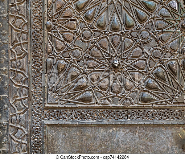 Ornaments of the bronze plate door of ancient historic mosque of Sultan Basque, Cairo, Egypt - csp74142284