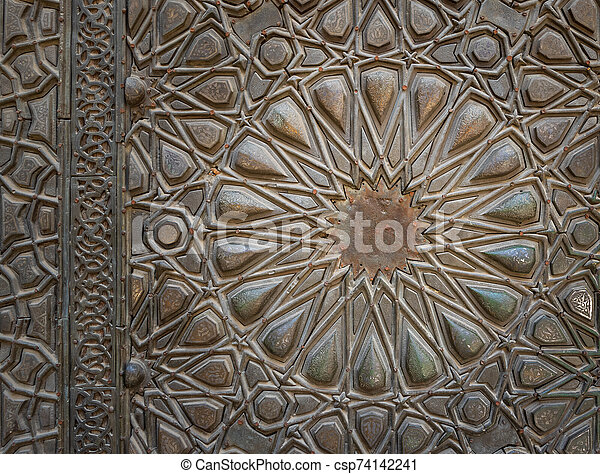 Ornaments of the bronze plate door of ancient historic mosque of Sultan Basque, Cairo, Egypt - csp74142241