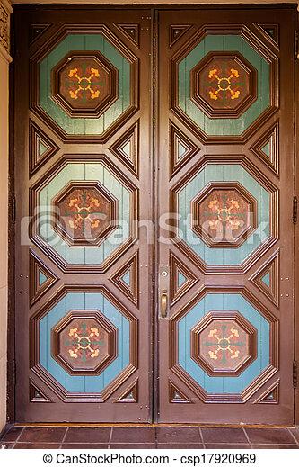 Ornate door - csp17920969 & Ornate door. Front view of blue and brown ornate door.