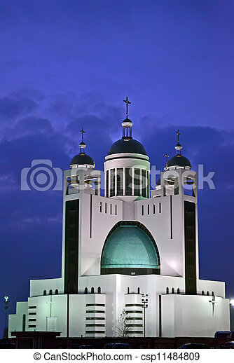 orthodox church with few golden cupola in the night illuminated with power lamps, religion details  - csp11484809