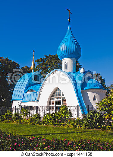 Orthodox white church with blue domes - csp11441158