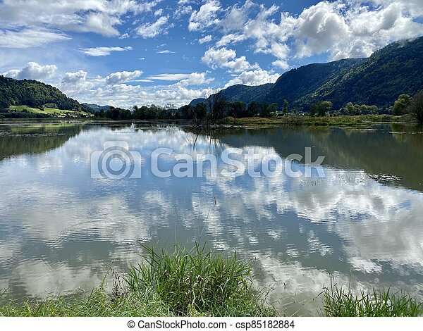 Ossiacher Lake in Carinthia, Austria on a summer day with great cloudscape being reflected in the Lake - csp85182884