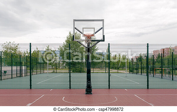 Outdoor basketball court in a public park. - csp47998872