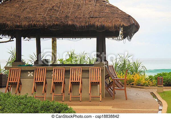 Outdoor cafe on the beach - csp18838842