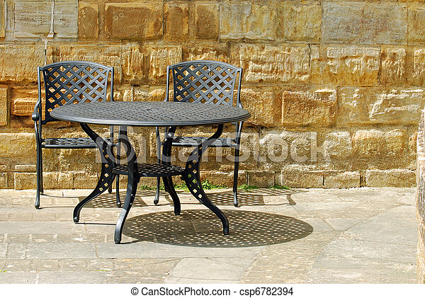 outdoor patio set with rock wall - csp6782394