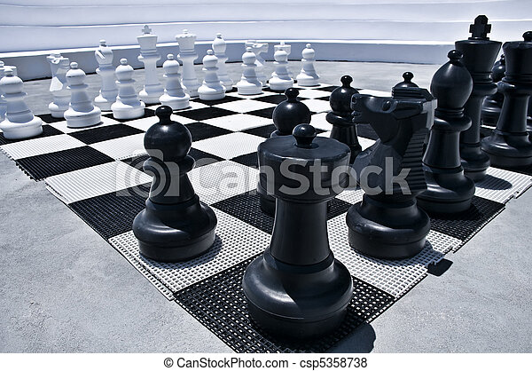 Outdoor playing Chess - csp5358738