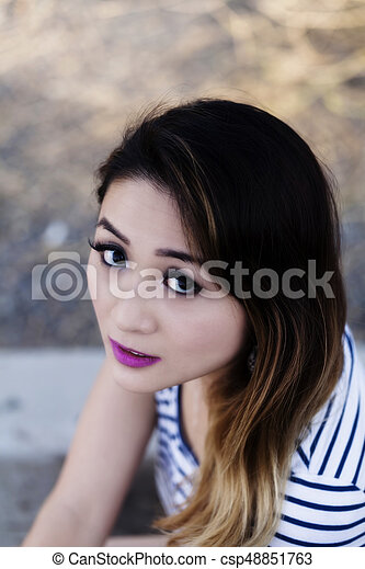 Outdoor Portrait Asian American Woman Looking Up - csp48851763