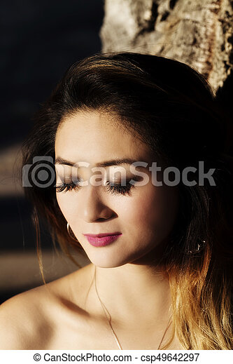 Outdoor Portrait Attractive Asian American Woman Eyes Closed - csp49642297
