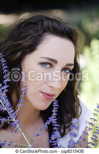 Outdoor portrait attractive young caucasian woman with flowers - csp8215438