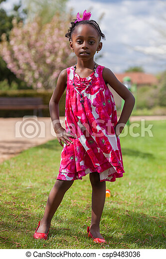 Outdoor portrait of a cute african american little girl - csp9483036